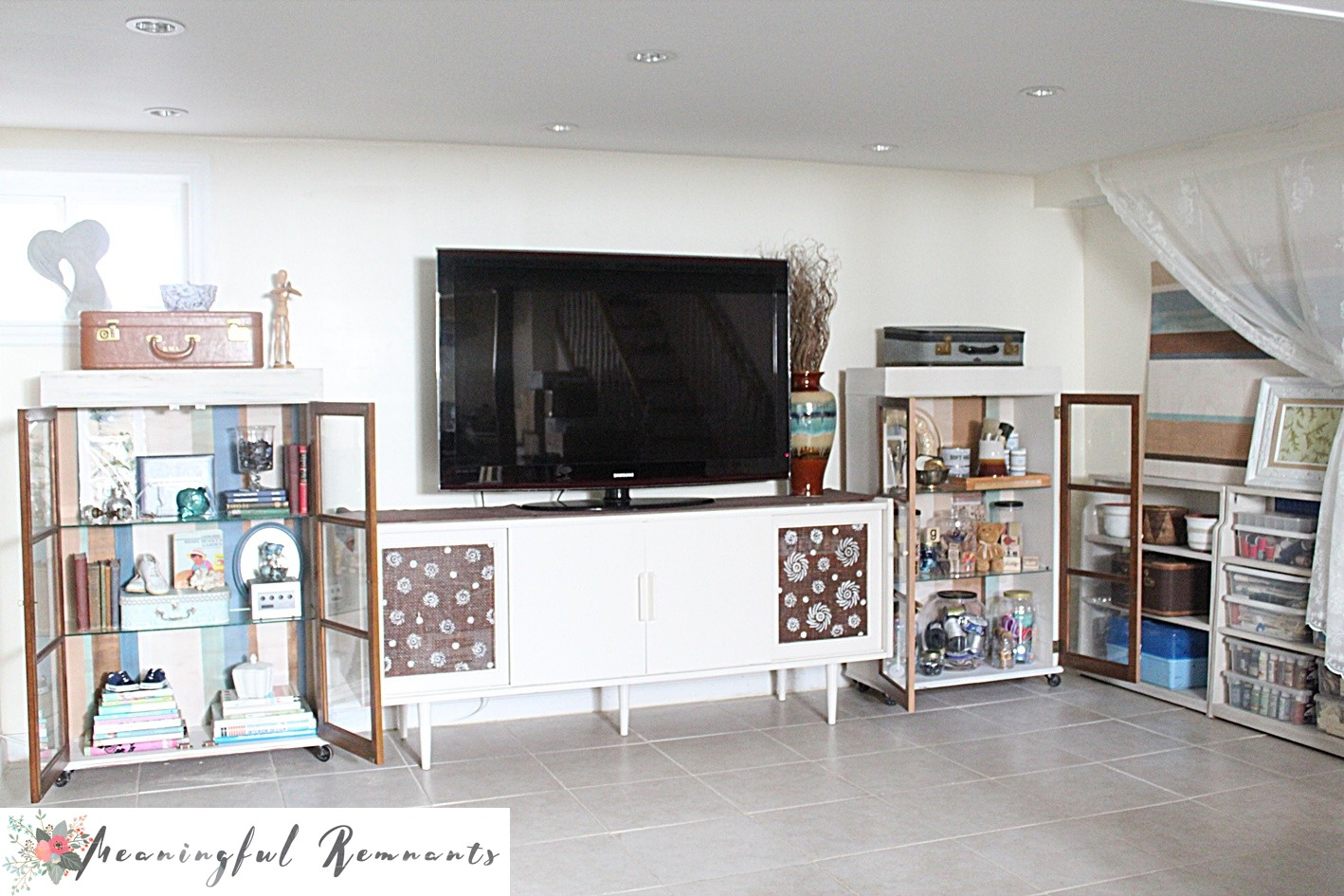 media cabinet flanked display cabinets